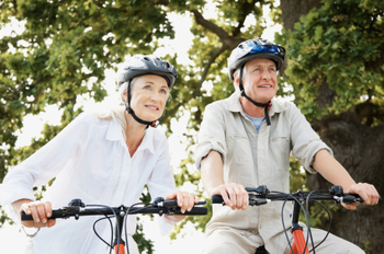 Senior couple enjoying a cycle ride together